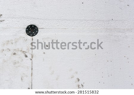 dirty Polystyrene insulation boards fixed with dowel - stock photo