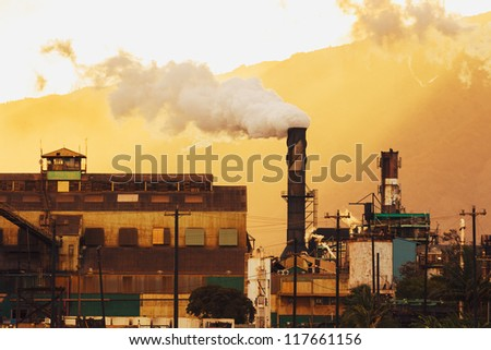 Dirty Power Plant Polluting Carbon into Atmosphere - stock photo