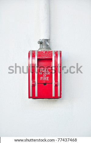 Dirty red fire alarm on white background