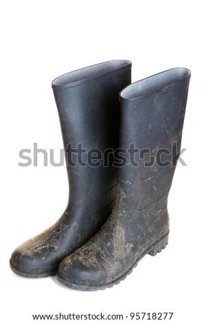 dirty rubber boots isolated on white - stock photo