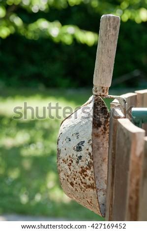 Dirty, rusty mortar mason hand tools trowel  - stock photo