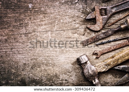 Dirty set of hand tools on a wooden background .  vintage photo - stock photo