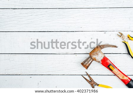 Dirty set of hand tools on old rusted sheet metal ,add your text on white background. - stock photo
