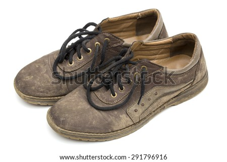 dirty shoes on the white background - stock photo