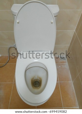 Dirty toilet in house and waiting for cleaning.