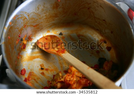 Dirty used stainless steel kitchen cooking stuff, pans - stock photo