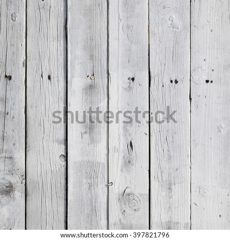 dirty vertical white planks on fence in square format