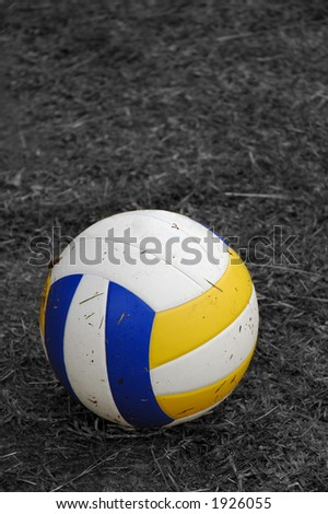 Dirty Volleyball on black and white field after play - stock photo