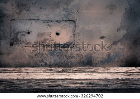 dirty wall and grunge weathered wood table - stock photo