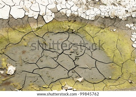dirty wasteland  drying wasted swamp with cracked bottom, trash everywhere - stock photo
