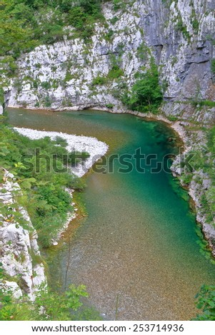 Dirty water flowing between tall walls of a canyon, Montenegro - stock photo