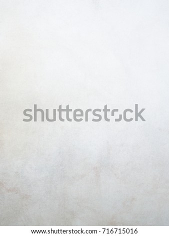Dirty white vintage canvas background with stains and pigments