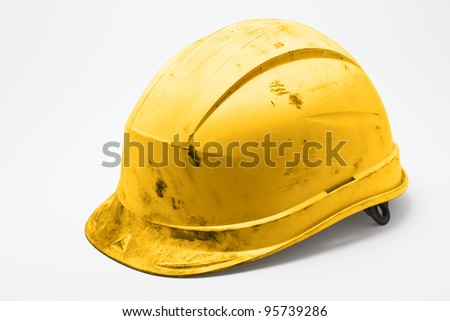 Dirty yellow hard hat on white background - stock photo