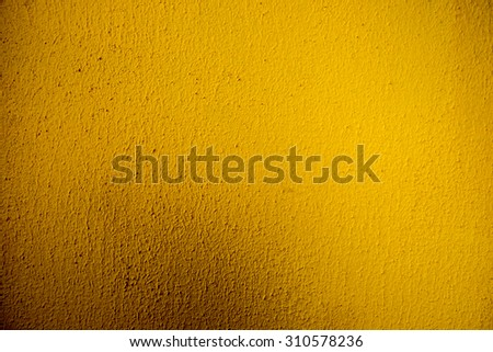 Dirty yellow  wall background. - stock photo