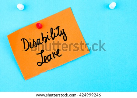 Disability Leave written on orange paper note pinned on cork board with white thumbtack, copy space available