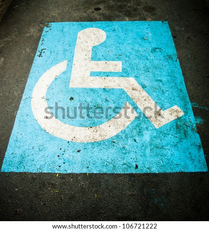 Disability sign in car parking - stock photo