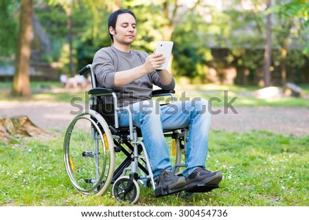 Disable man using a digital tablet  - stock photo
