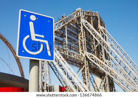 disabled access sign outside Khalifa sports stadium in Doha, Qatar, Middle East, where the 2006 Asian games were hosted and location for the proposed 2016 Olympic Games - stock photo