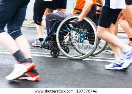 Disabled athlete in a sport wheelchair - stock photo