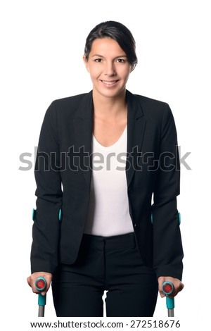 Disabled Businesswoman in Black and White Business Suit Walking with Two Crutches, Isolated on White Background. - stock photo