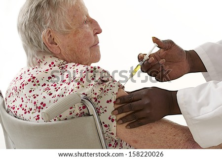 disabled elderly woman injection - stock photo