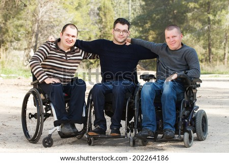 Disabled Happy friends having fun together outside.