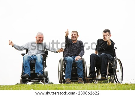 Disabled Happy friends  with thumbs up. - stock photo