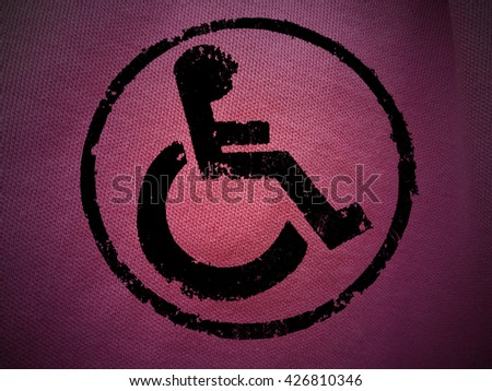 disabled icon sign, pink old wall background. - stock photo