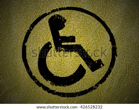 disabled icon sign, yellow old wall background. - stock photo