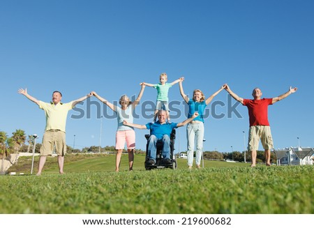 Disabled man and Group of Happy People smiling and show unity. - stock photo