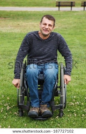Disabled men smiling in a wheelchair