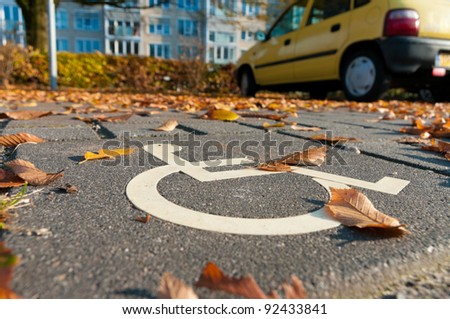 disabled parking permit sign painted on the street - stock photo