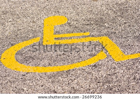 disabled parking sign on asphalt texture - stock photo