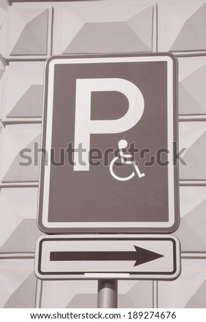 Disabled Parking Sign on Cream Wall Background