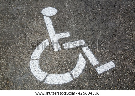 Disabled Parking Sign on Street Surface