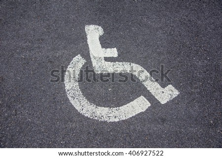 Disabled parking sign on the parking lot - stock photo
