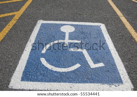disabled parking sign painted on tarmac - stock photo
