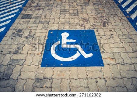 Disabled permit sign on parking lot