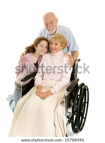 Disabled senior lady with her loving husband and granddaughter. - stock photo