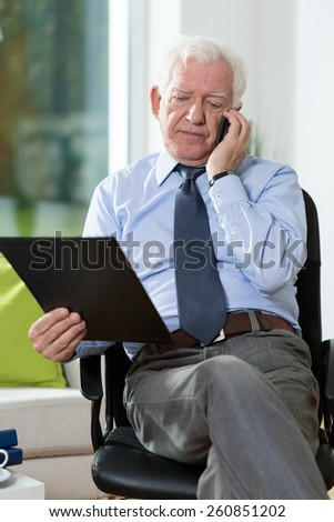 Disabled senior man talking on the phone - stock photo