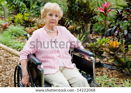 Disabled senior woman alone and suffering from depression.