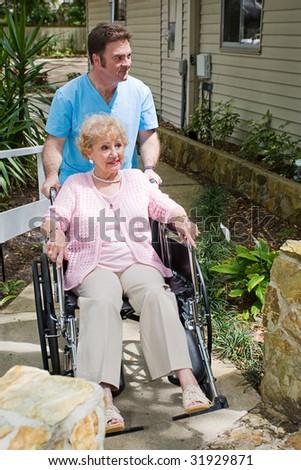 Disabled senior woman nervous about entering a nursing home. - stock photo