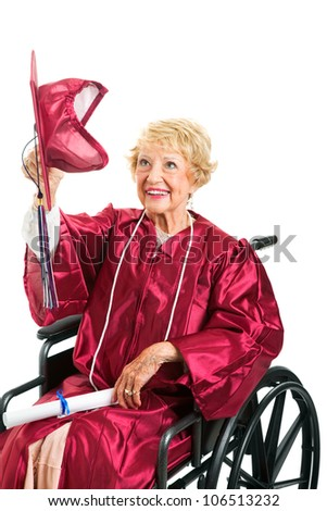 Disabled senior woman removes her graduation cap to throw it up in the air.  Isolated on white. - stock photo