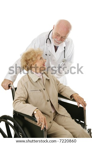Disabled senior woman trusts her mature, kind doctor.  Isolated on white. - stock photo