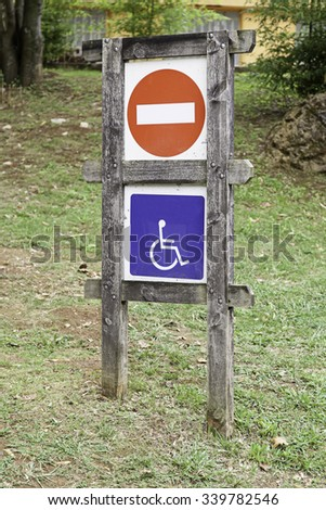 Disabled sign, detail of an information signal - stock photo