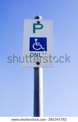 Disabled sign. Flat style icon, a symbol for the disabled. - stock photo