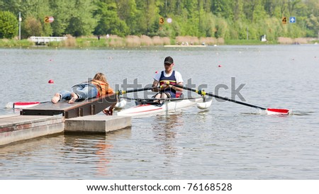 Disabled skiff rower, during the first strike of a rowing race, fresh from the start - stock photo