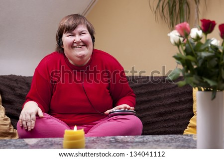 Disabled woman experiencing music and looks forward - stock photo