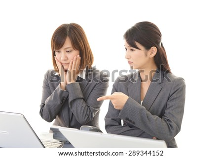 Disappointed Asian business women