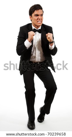 Disappointed investor in rage holding his fists, isolated on white